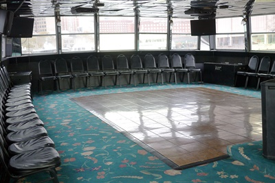 NY charter yacht Lucille dance floor and chairs