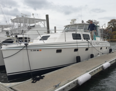 NY motor catamaran yacht 18 dockside