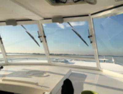 NYC catamaran yacht 18 helm